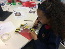 Child making a bee hotel